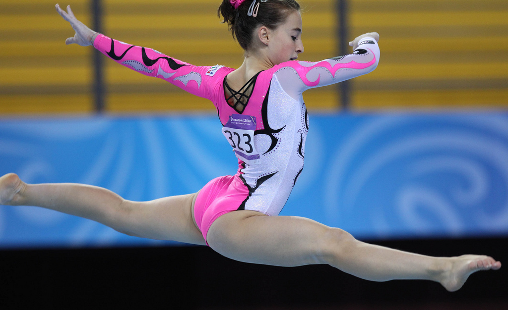 SINGAPORE. 19 Aug 2010 - Carlotta Ferlitoof Italy competes during women's individual all-around final of artisic gymnastics at the SINGAPORE 2010 Youth Olympic Games in SINGAPORE,August 19,2010. Carlotta Ferlit took bronze medal of the event. XINHUA/SYOGOC-Pool/Cai Yang